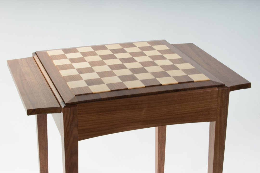 Personalize the chess table with a raised panel wooden board