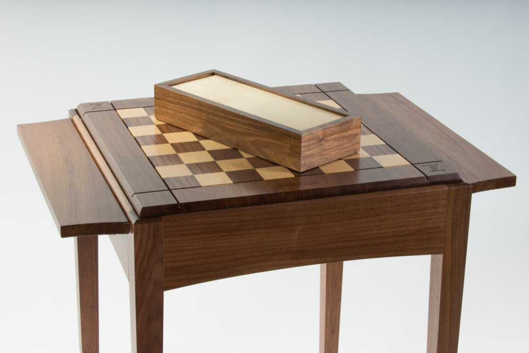 Chess table with matching hardwood box in walnut and maple.
