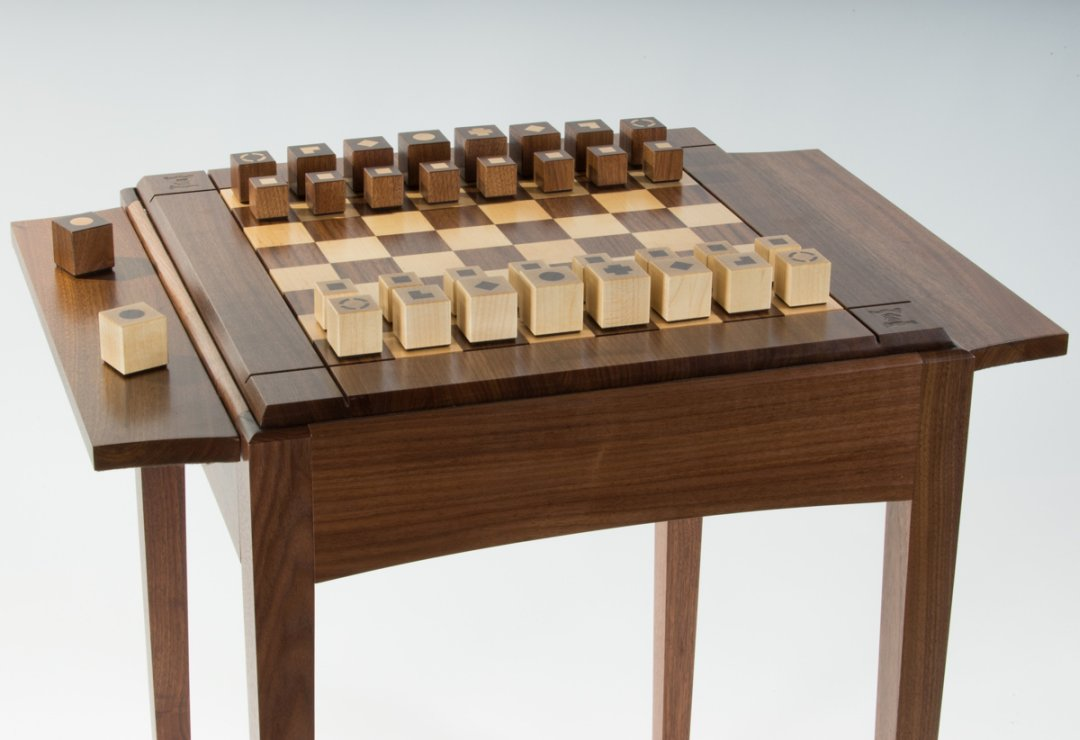 Chess table with in-house design pieces setup.