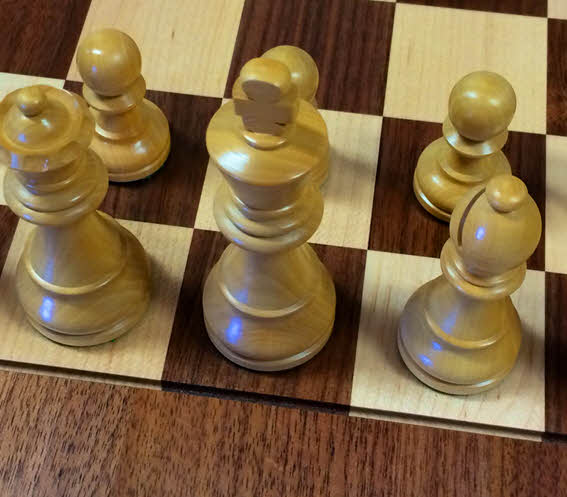 Timeless pieces on premium USA hardwood chessboard